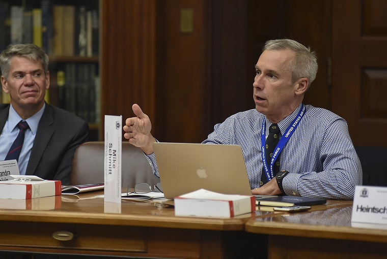 Christopher Harland, a legal advisor with the International Committee of the Red Cross (ICRC) and Michael Schmitt, professor, U.S. Naval War College's (NWC) Stockton Center for the Study of International Law, participate in a discussion during a legal conference held at NWC.